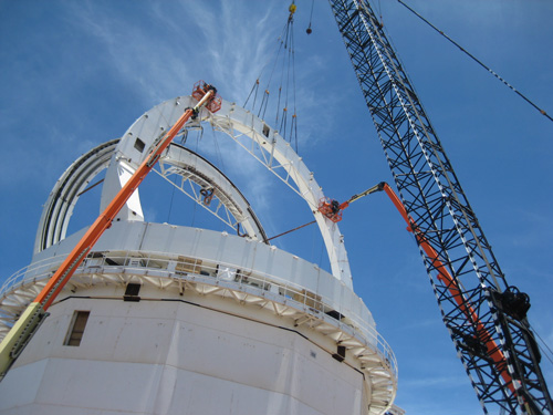 The main structural elements of the DKIST enclosure being installed; the basket on the crane with people in it gives an idea of the scale.